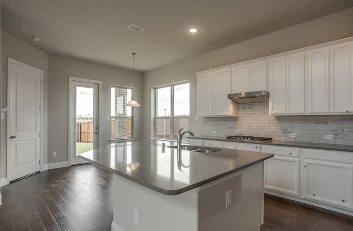 Fairfield quick move-in open kitchen with large island that opens to breakfast nook