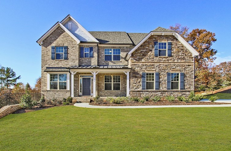 Two-story brick front home with stone accents