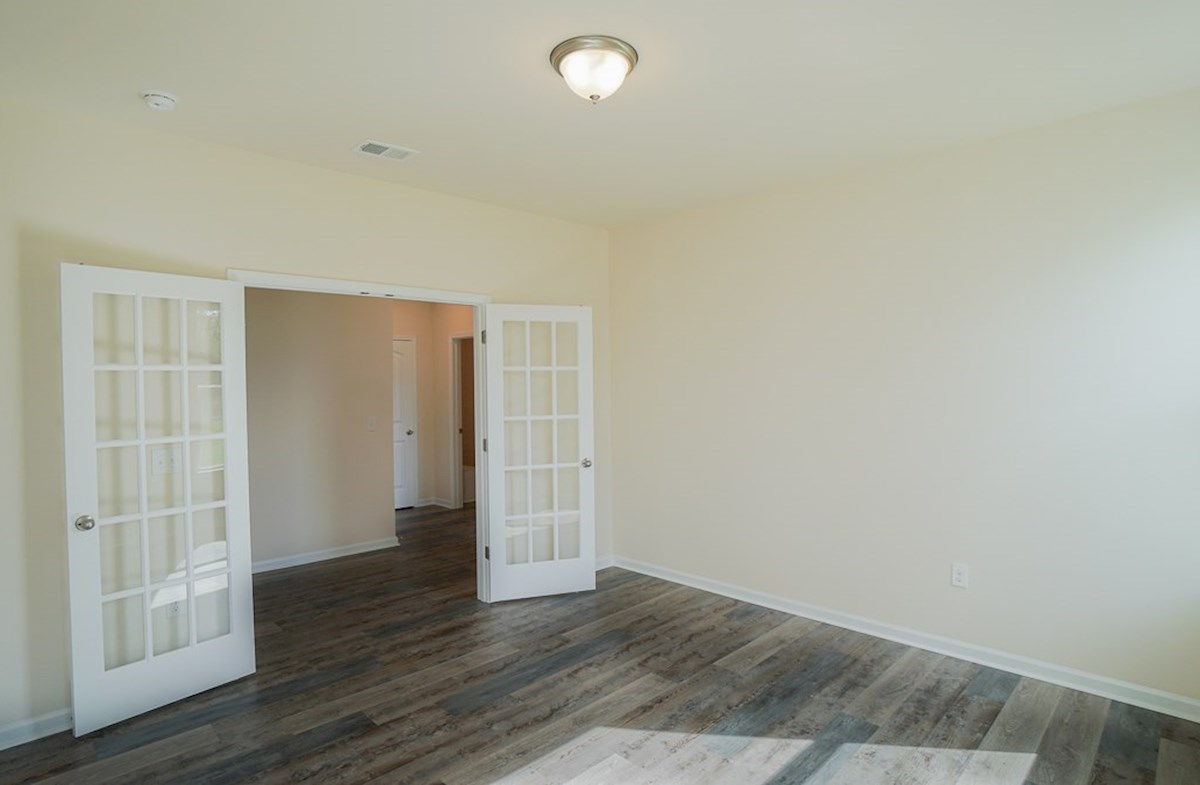 Georgetown quick move-in study features French doors and luxury vinyl plank flooring