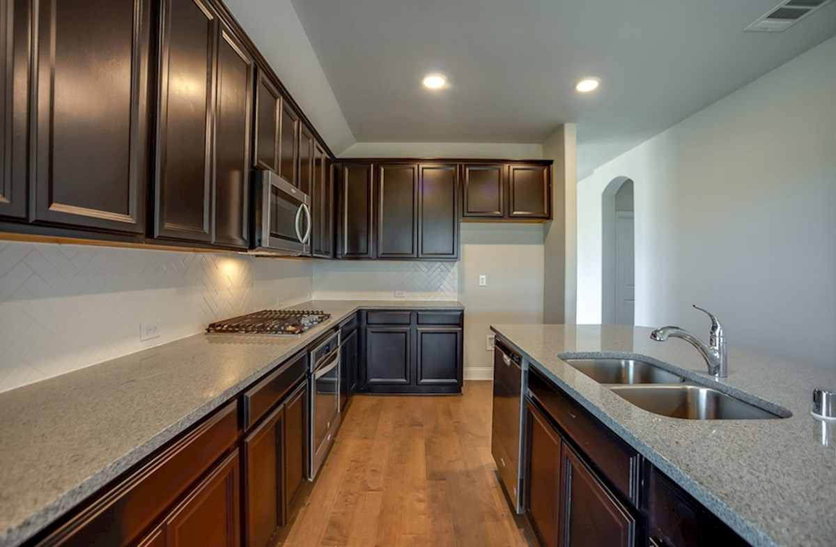 Millbrook quick move-in kitchen with granite countertops