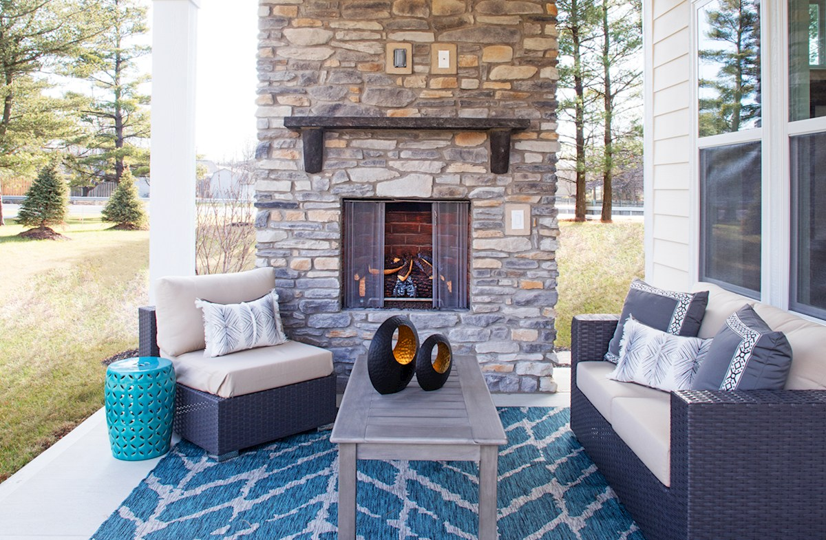 Windsor with an outdoor stone fireplace