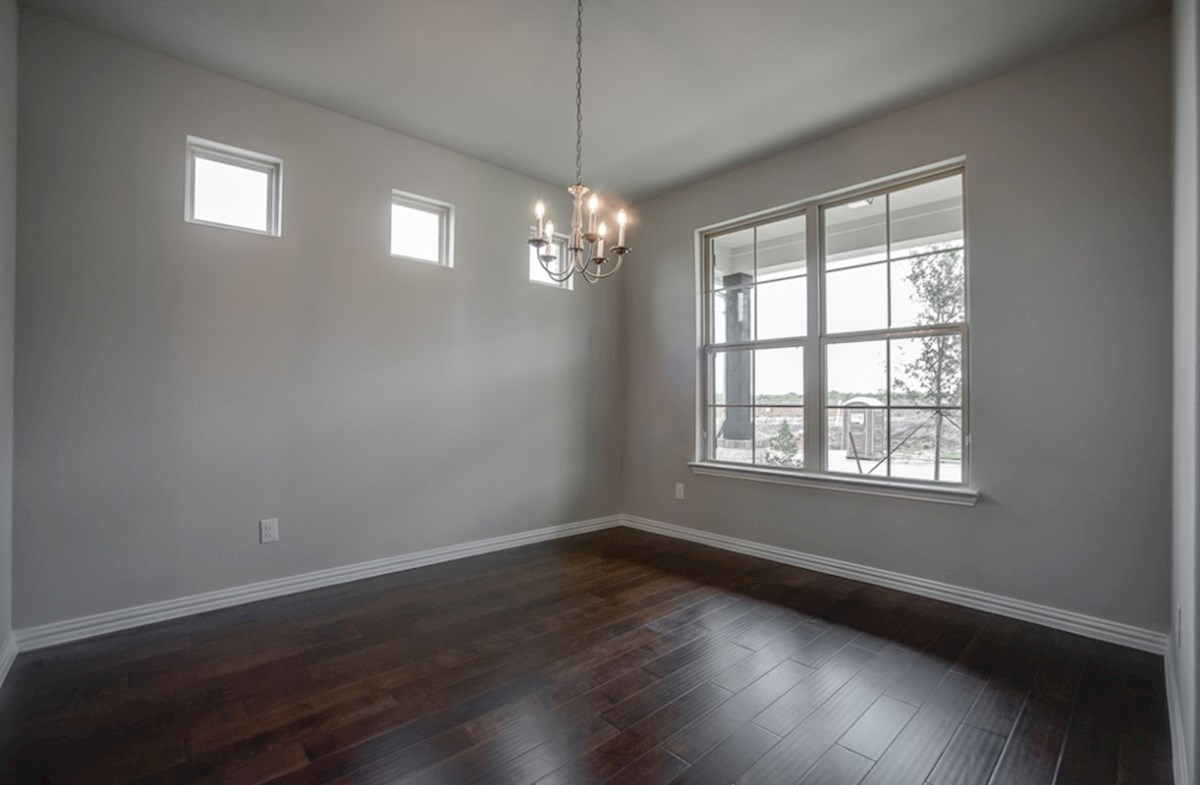 Eastland quick move-in open dining room with wood floors