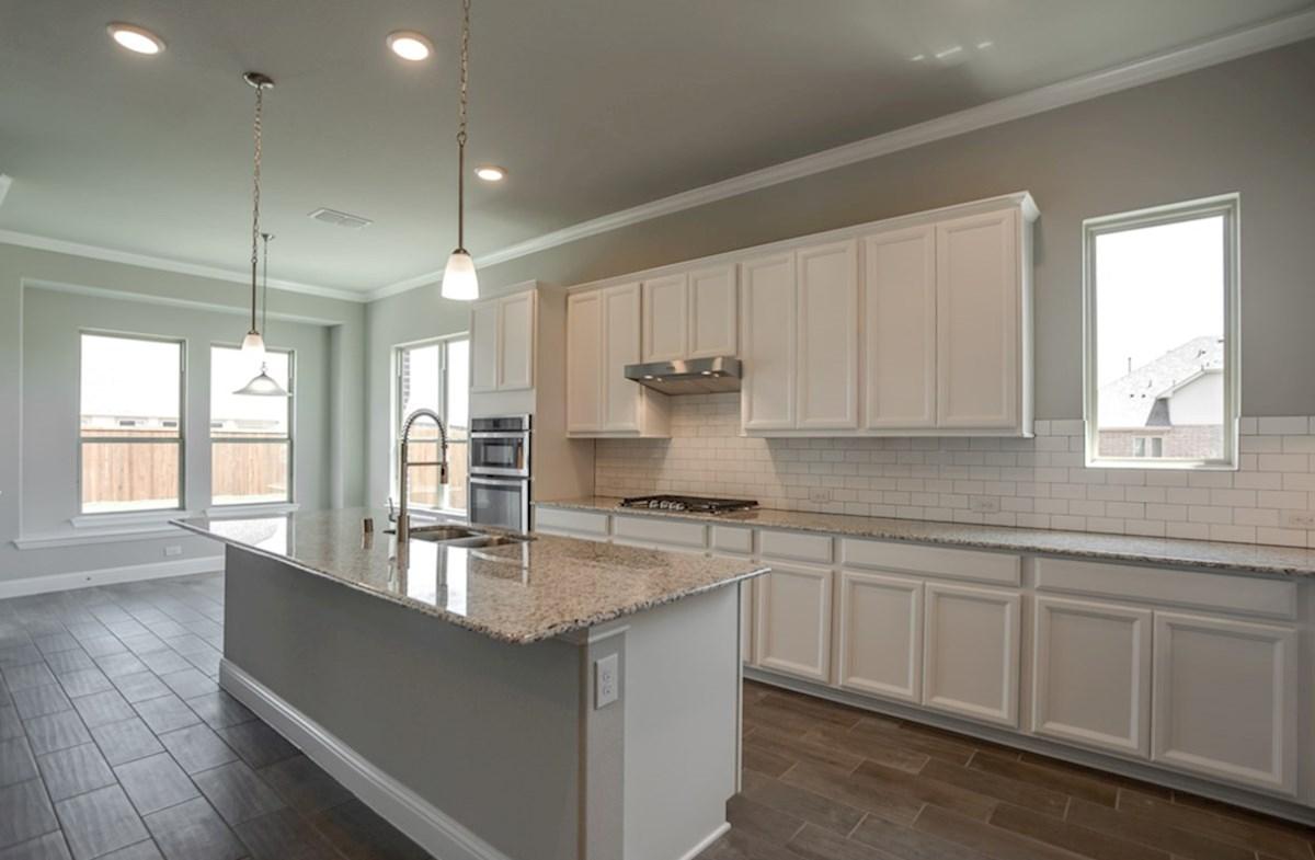 Summerfield quick move-in open kitchen next to bright breakfast nook