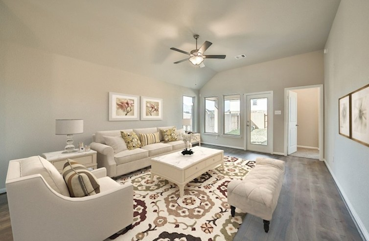 Villages at Harmony Hickory great room with wood flooring and ceiling fan