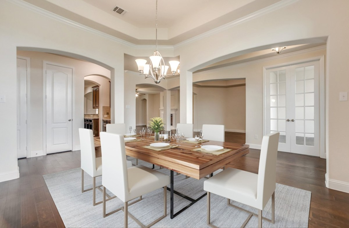 Stoney Creek Degrey Degrey formal dining room with tray ceiling