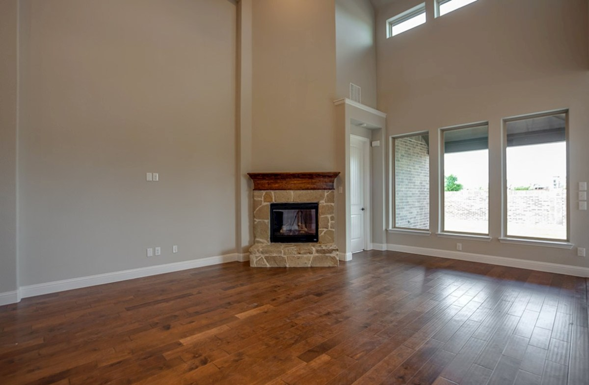Summerfield quick move-in open great room with stone fireplace and wood floors