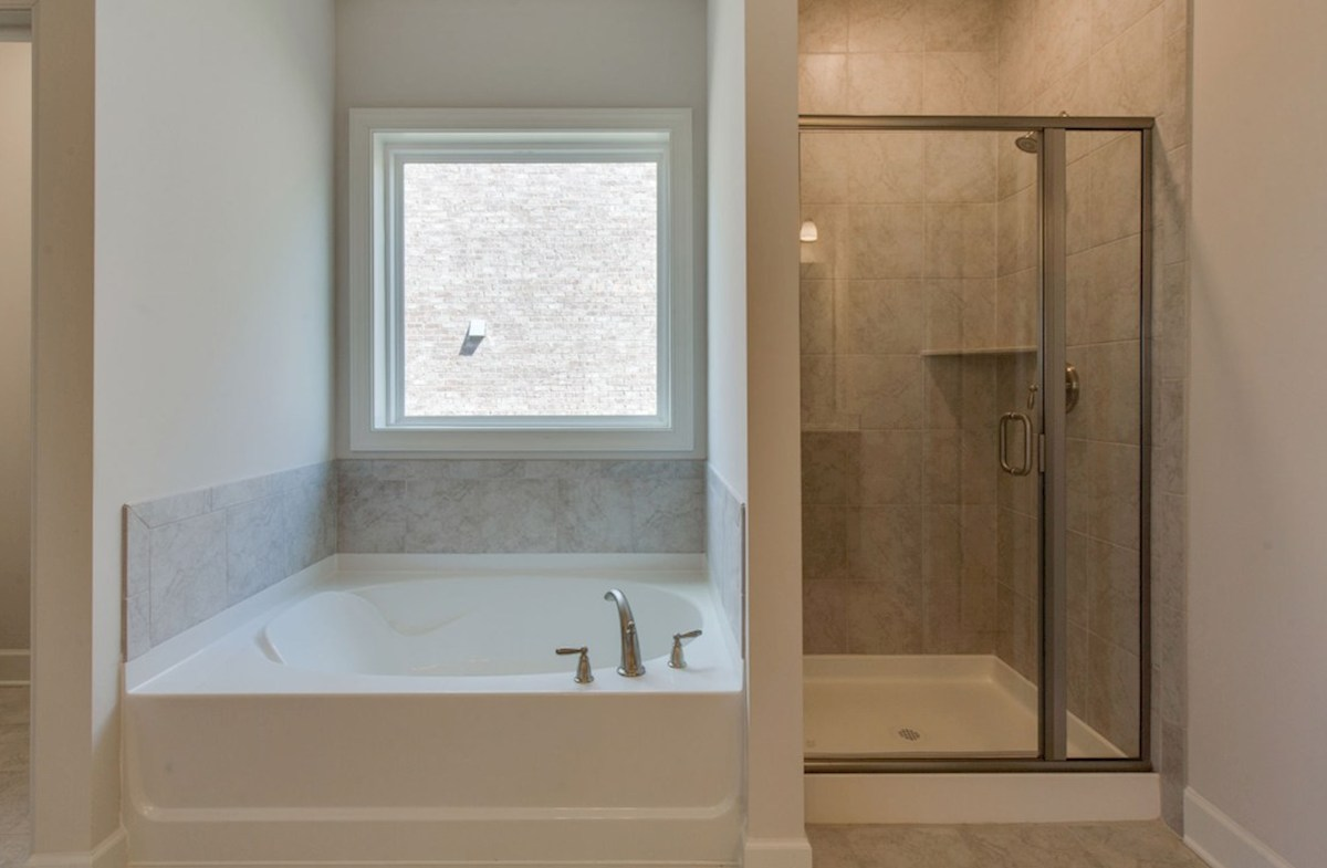 Oxford quick move-in master bath featuring a soaking tub and walk-in shower