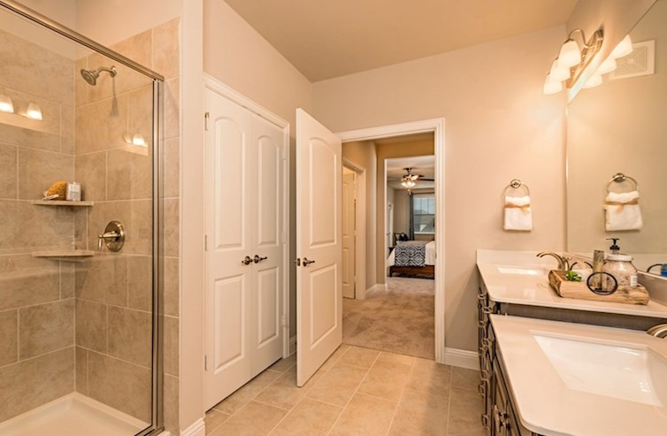 Gatherings® at Westview Dorset master bathroom with double sinks and tile flooring