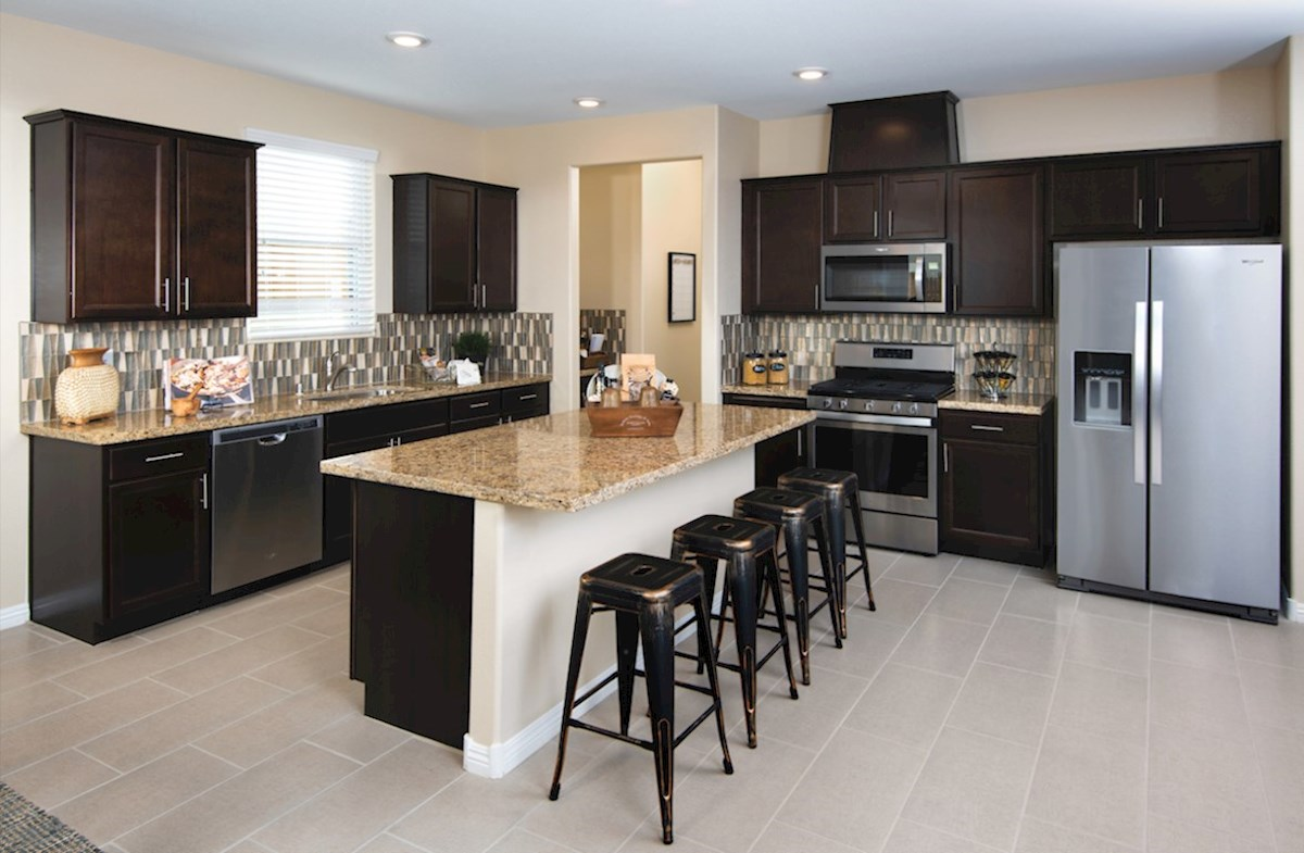 Sedona quick move-in kitchen features granite countertops in the Sedona model