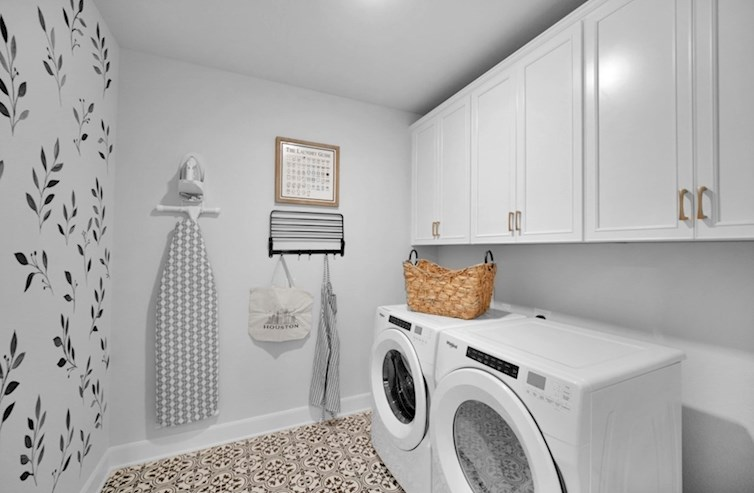 Dorset laundry room with storage cabinets