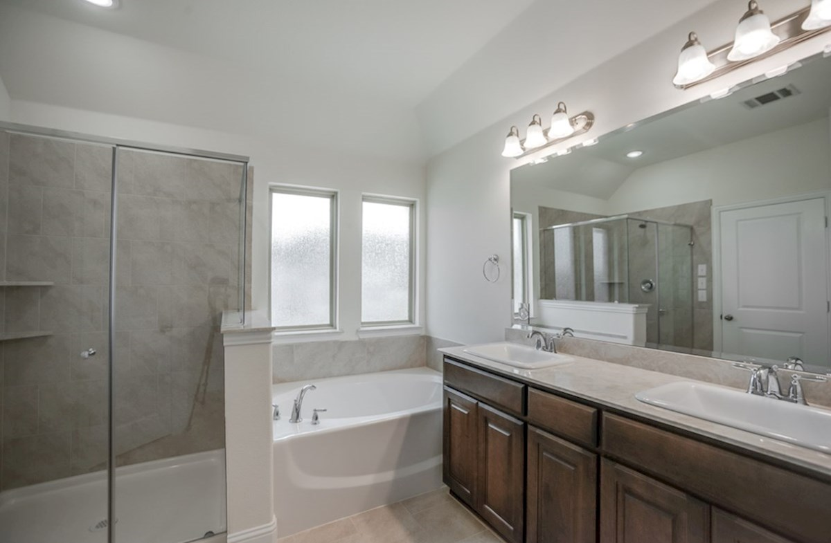 Whitney quick move-in master bathroom with walk-in shower and soaking tub