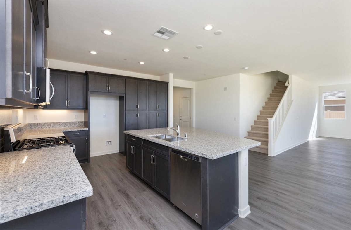 Reserve quick move-in Granite countertops and center island with sink provide the ideal location for food preparation