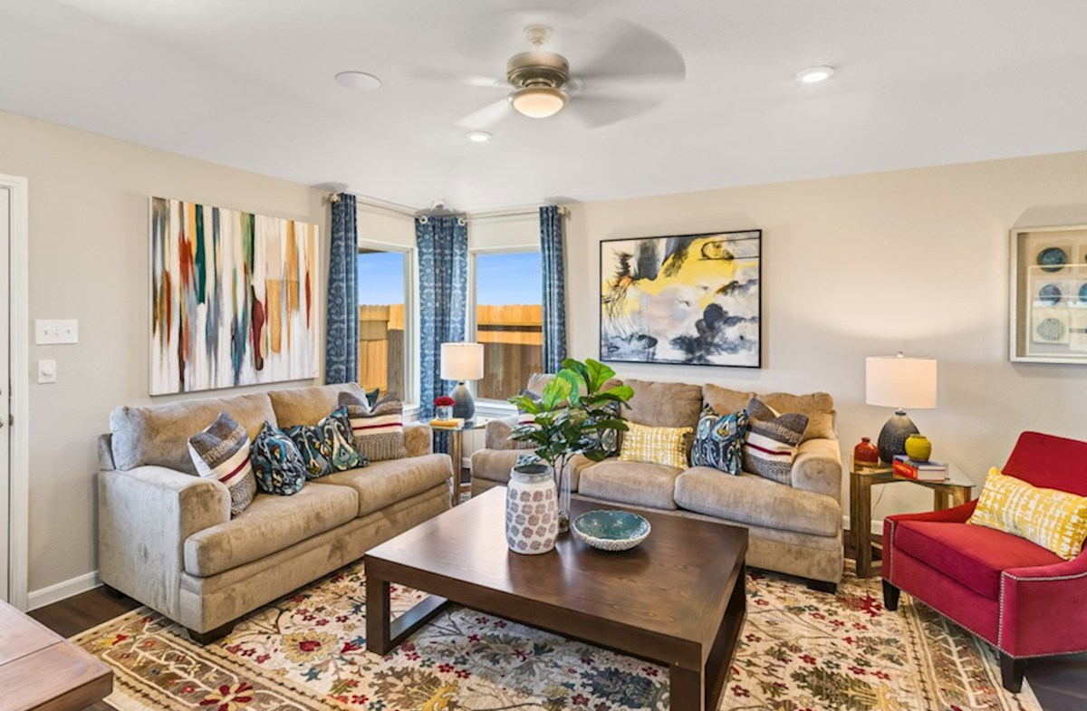 Lantana Austin great room with ceiling fan and wood-like flooring