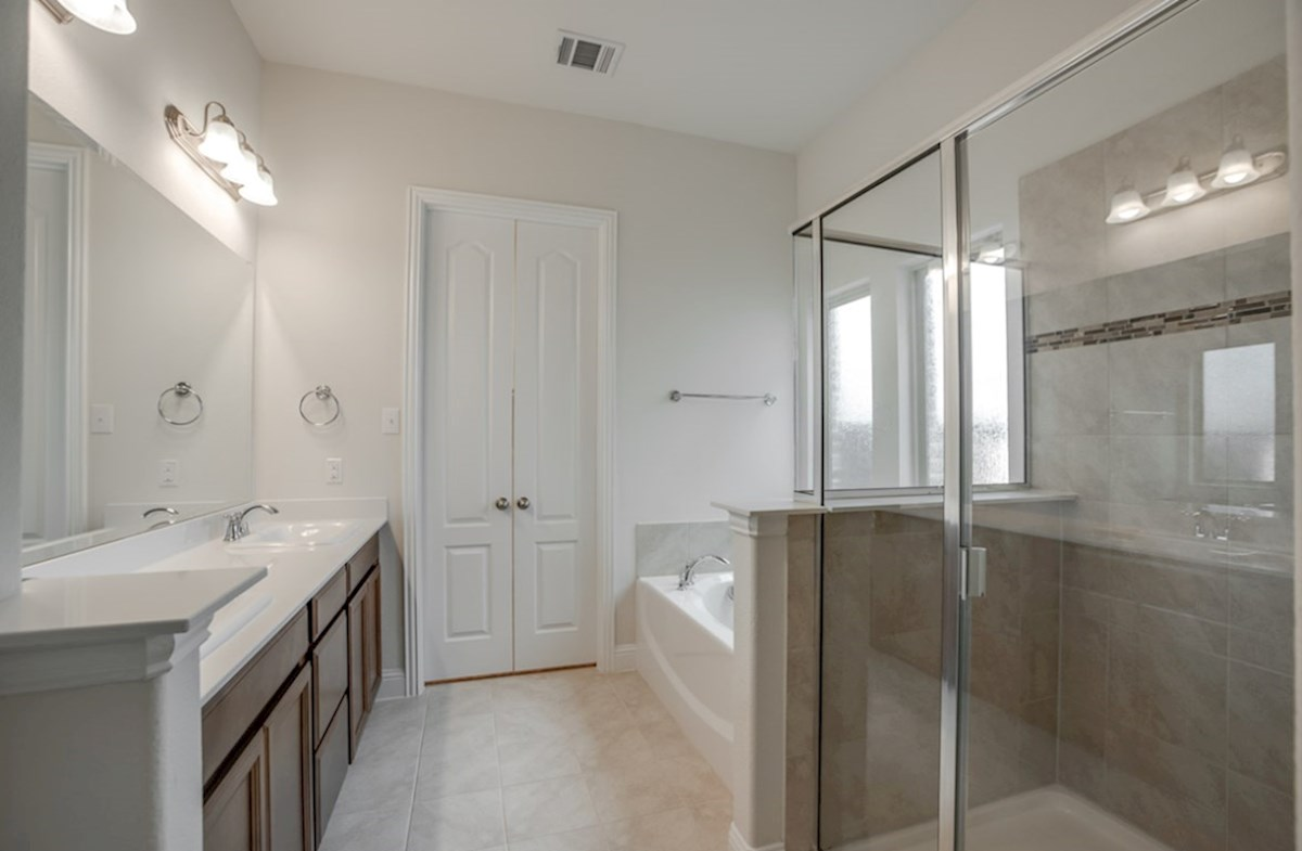 Valencia on the Lake Wimberley Wimberley master bathroom with separate tub and shower