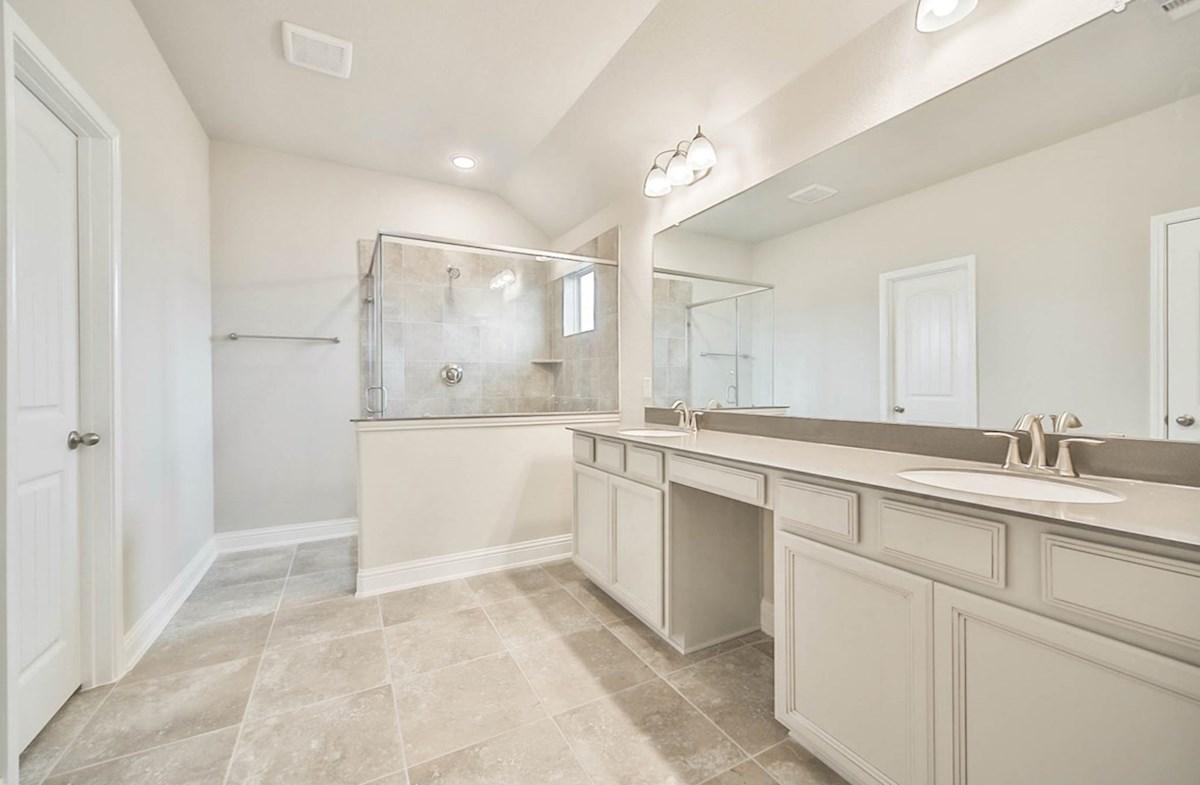Juniper quick move-in master bathroom with vanity and tile floor