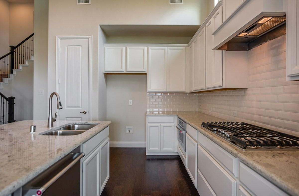 Richland quick move-in kitchen includes white cabinets and granite countertops