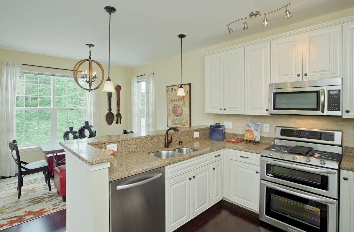 Gatherings® at Quarry Place Dogwood stainless appliances in kitchen
