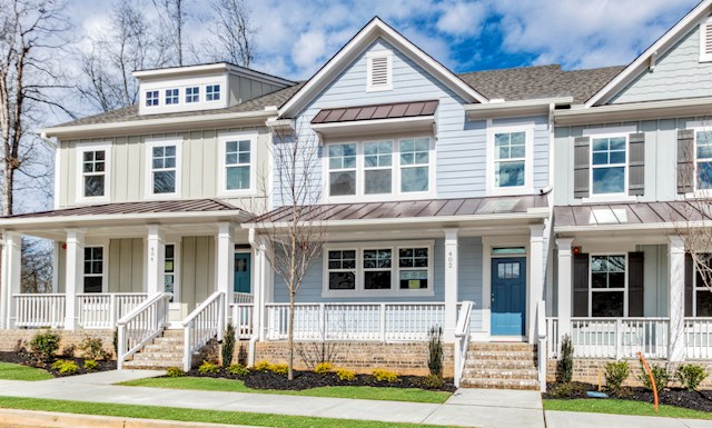 Three-story townhome with front porch
