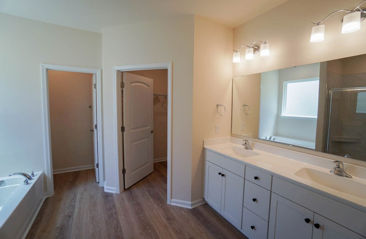 Camden quick move-in master bathroom features double vanities