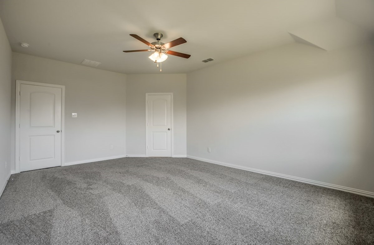 Silverado quick move-in master bedroom with carpeting