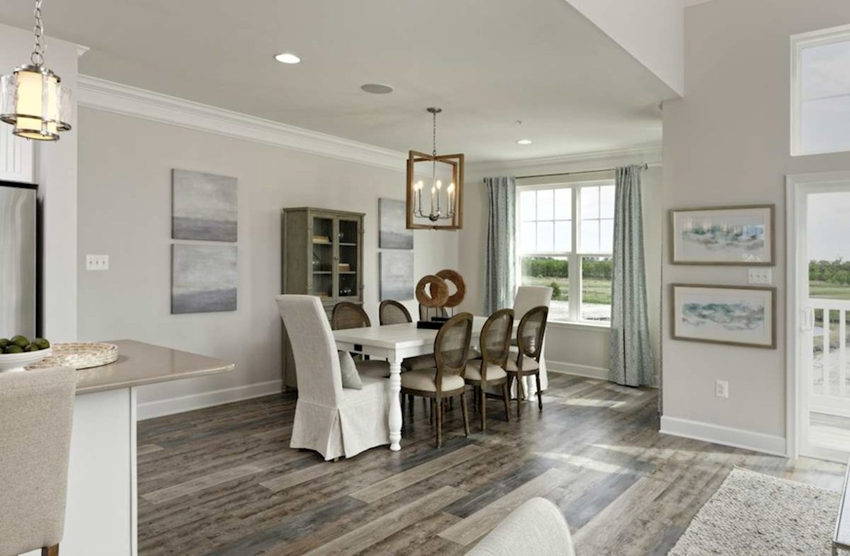 Harbor Crest at Bayside Fenwick Open dining room featuring hardwood floors