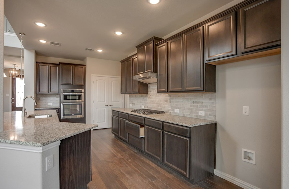 Brookhaven quick move-in open kitchen with large island and dark cabinets