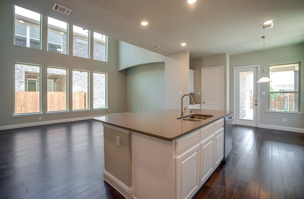 Whitney quick move-in kitchen opens to great room