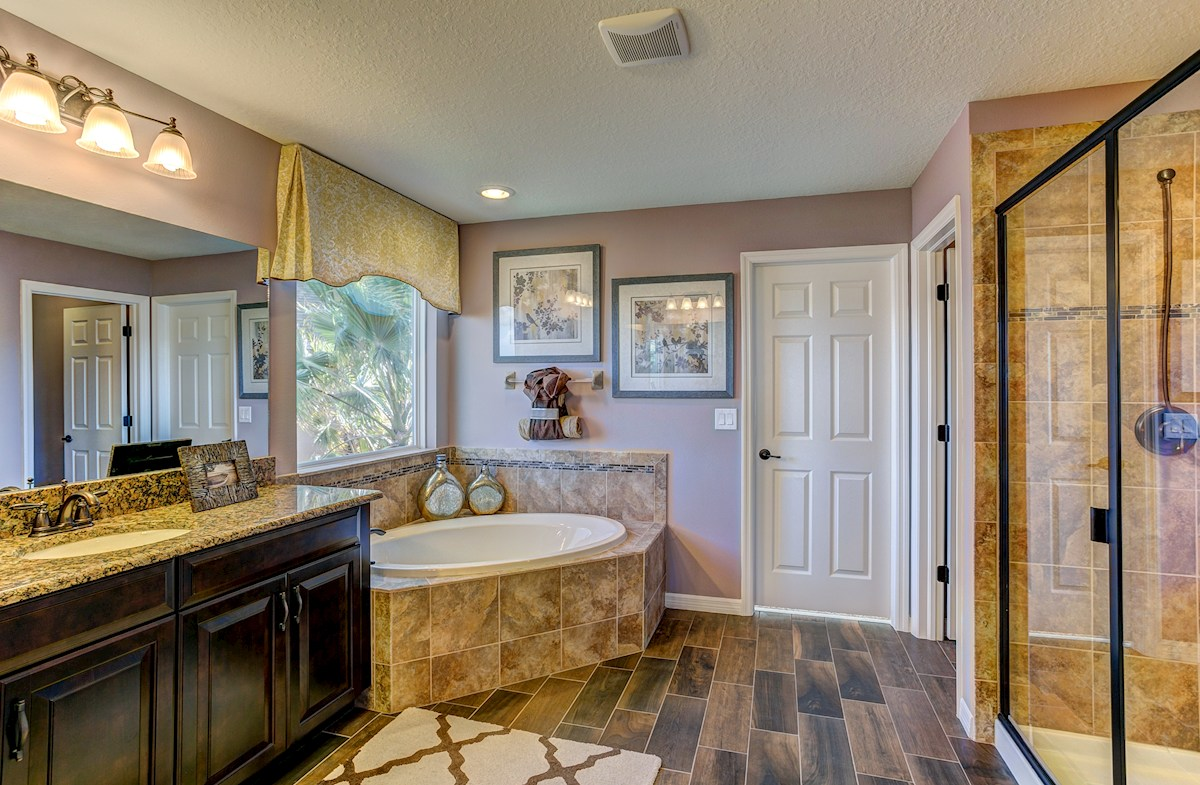 The Reserve at Pradera Captiva oil-rubbed bronze bathroom with garden tub