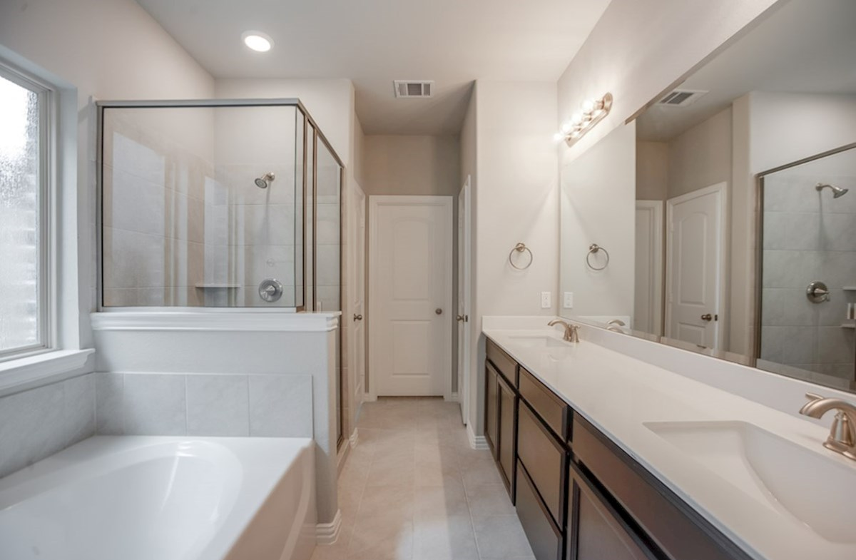 Eastland quick move-in master bathroom with walk-in shower and soaking tub