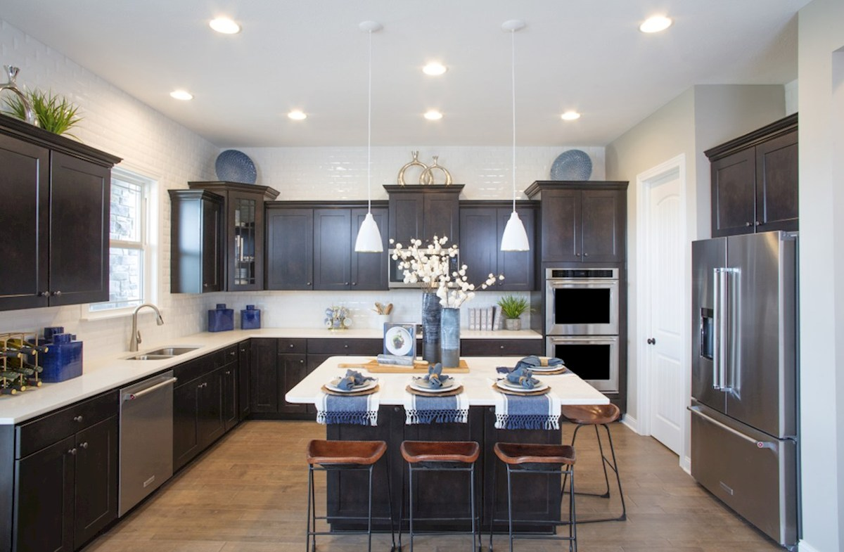 Hampshire Meridian Collection Tarkington open kitchen with chef's island and stainless steel appliances