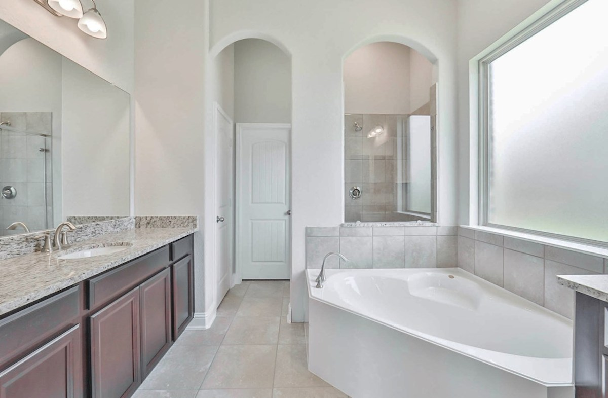 Galveston quick move-in master bathroom with tile flooring