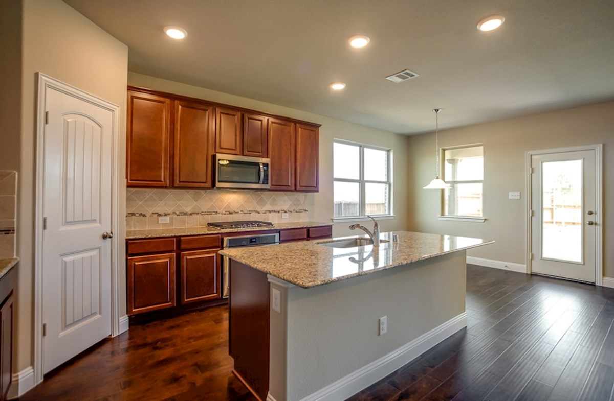Avalon quick move-in kitchen with wood flooring