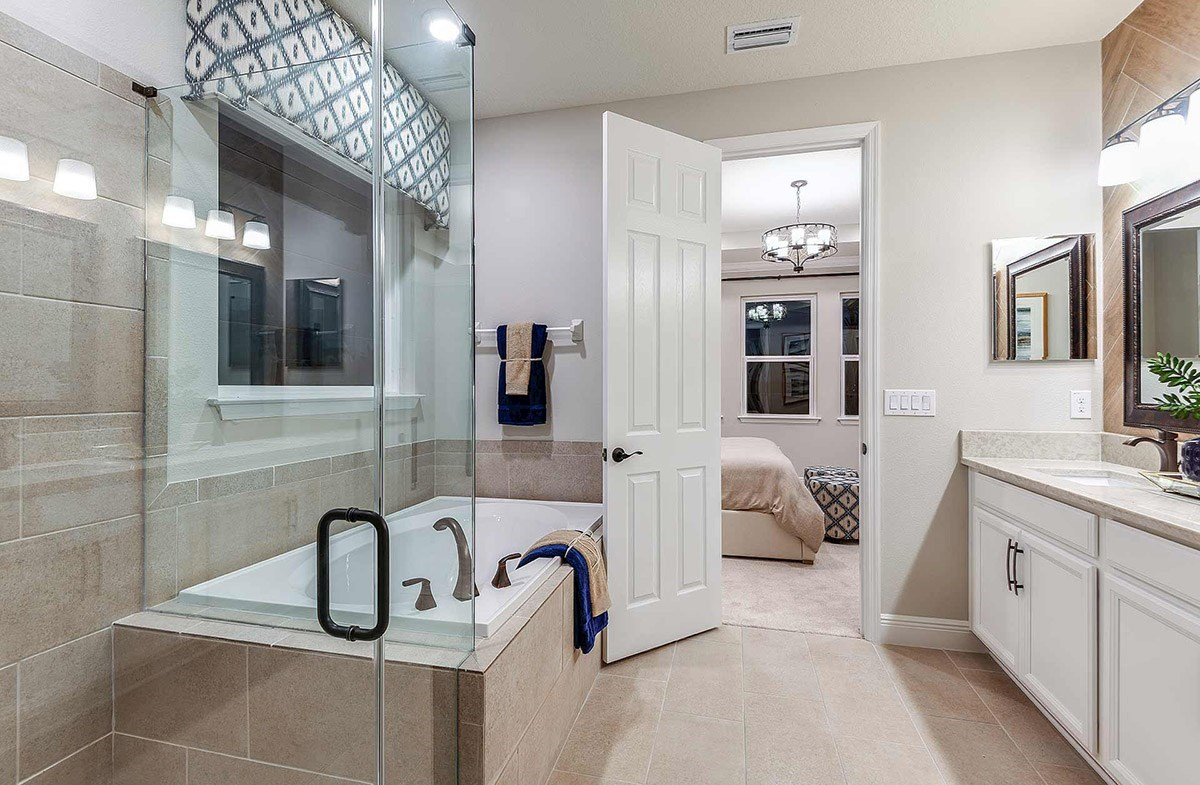 Waterset Bayview Master bathroom with glass enclosed shower and dual vanity