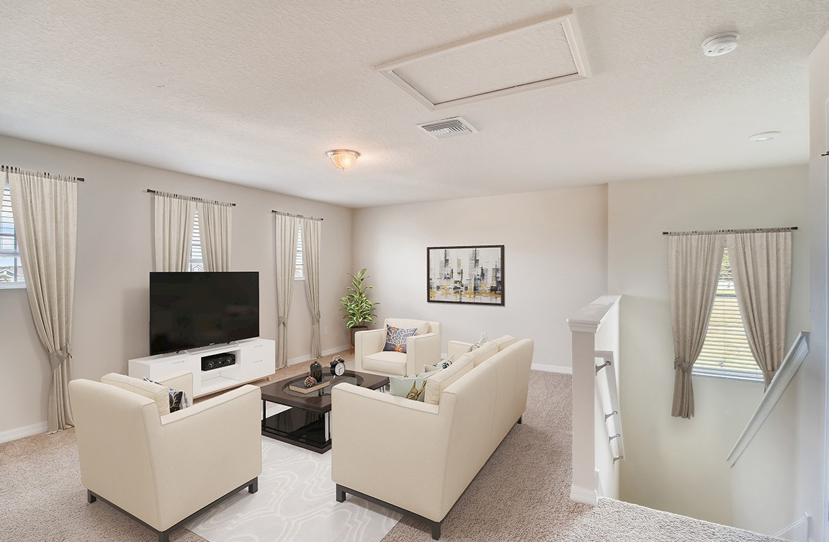 The Reserve at Pradera Sanibel Spacious loft virtually staged as a family room
