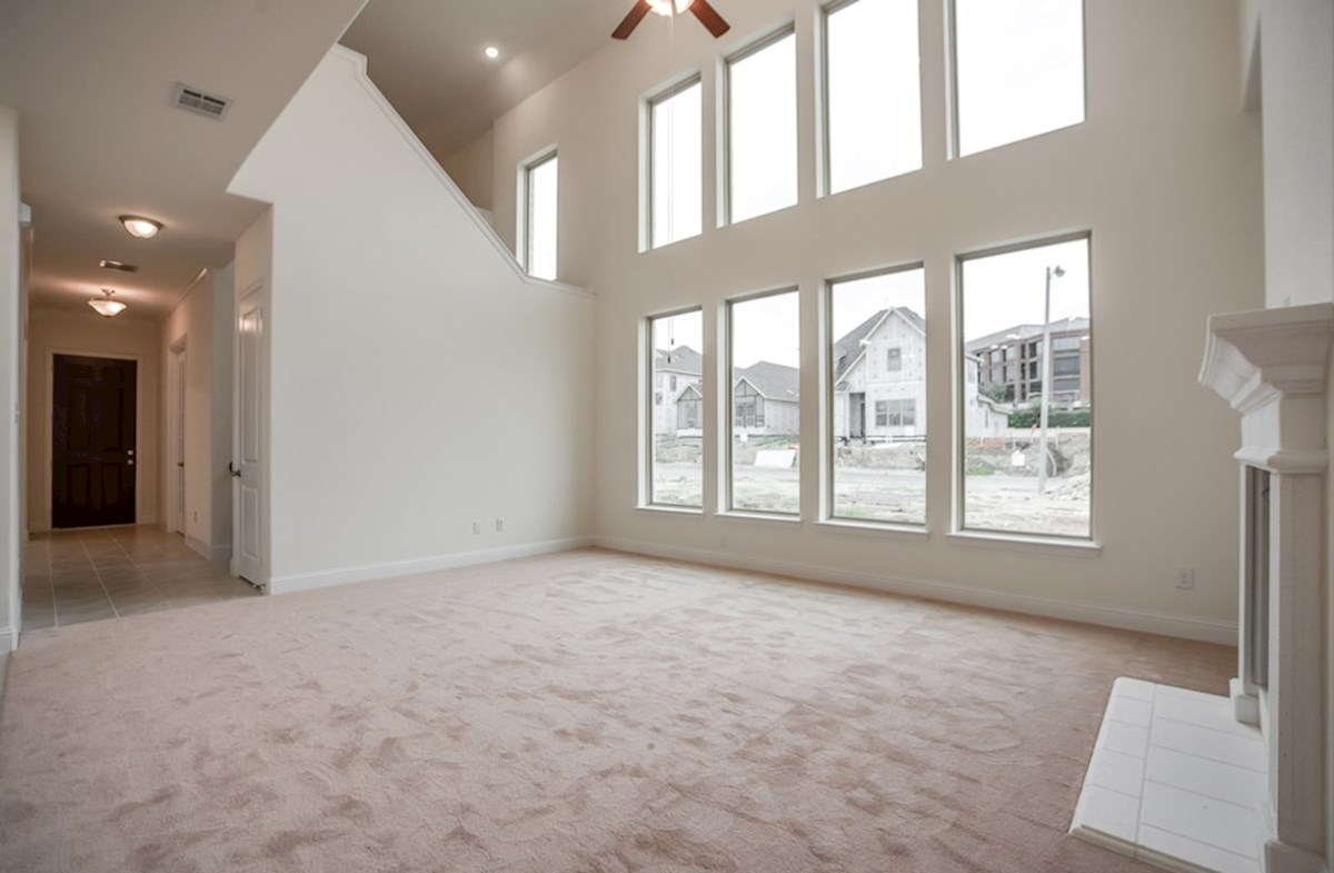 Whitney quick move-in great room with high ceilings and windows