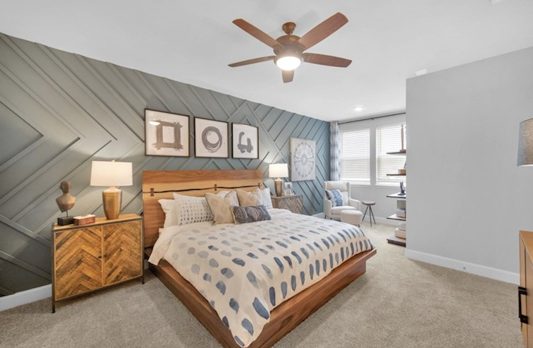 Clifton primary bedroom with carpet floors and ceiling fan