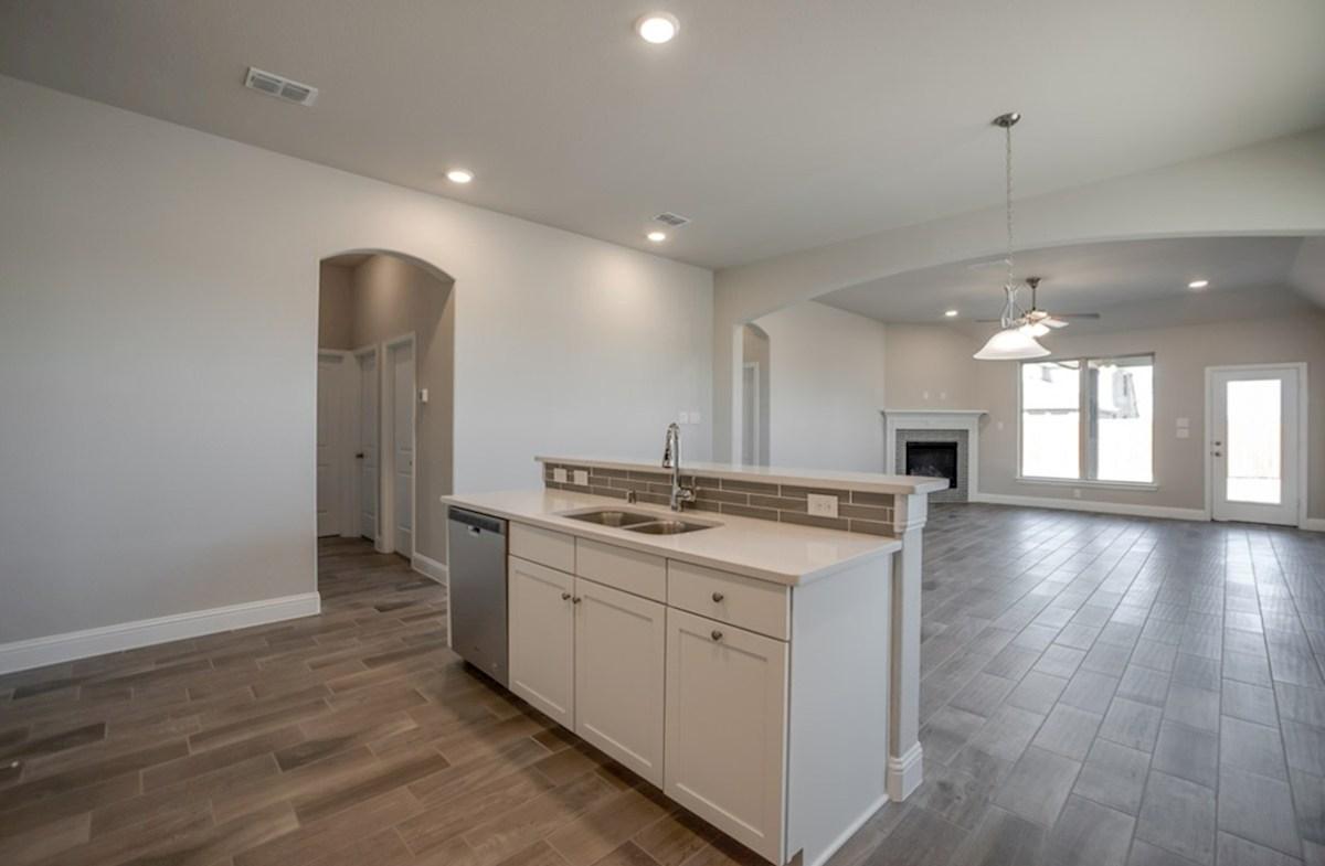 Silverado quick move-in Silverado kitchen with island facing great room