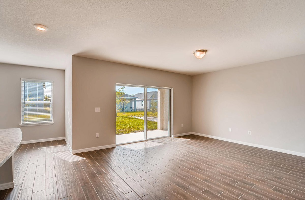Cypress Pointe quick move-in Great room with large sliding glass door for backyard views