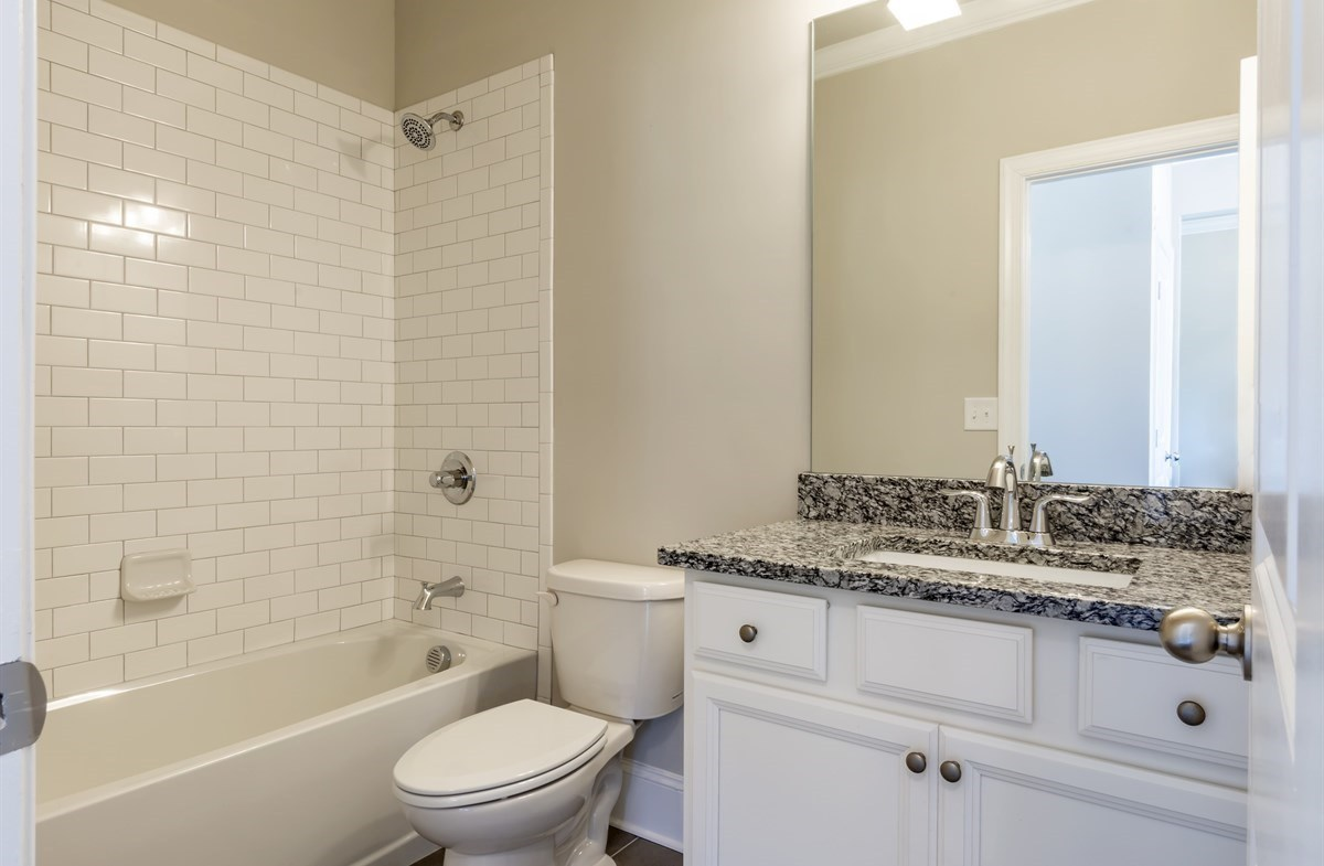Brentwood quick move-in Secondary Bathroom with granite countertops