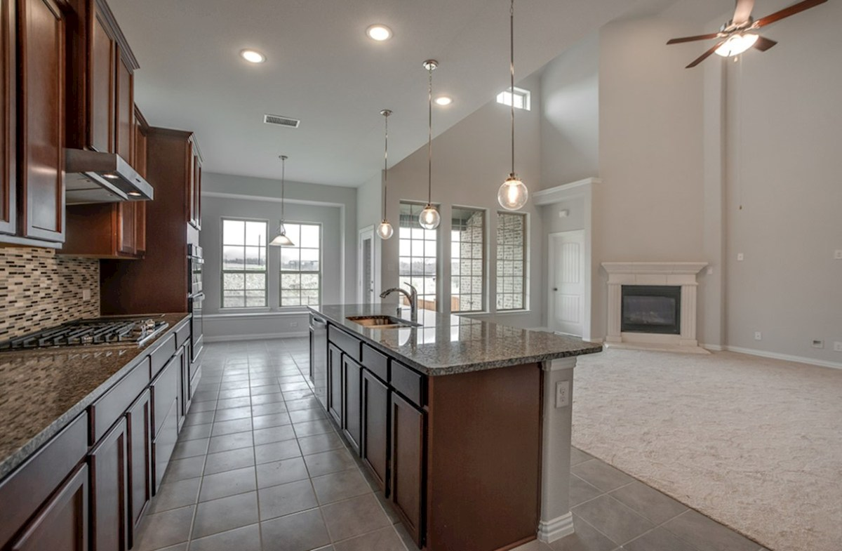 Summerfield quick move-in Summerfield kitchen opens to great room