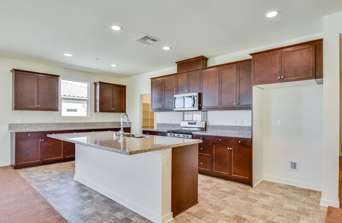Agave quick move-in Gourmet kitchen boasts an oversized island, stainless steel appliances, and stunning granite countertops