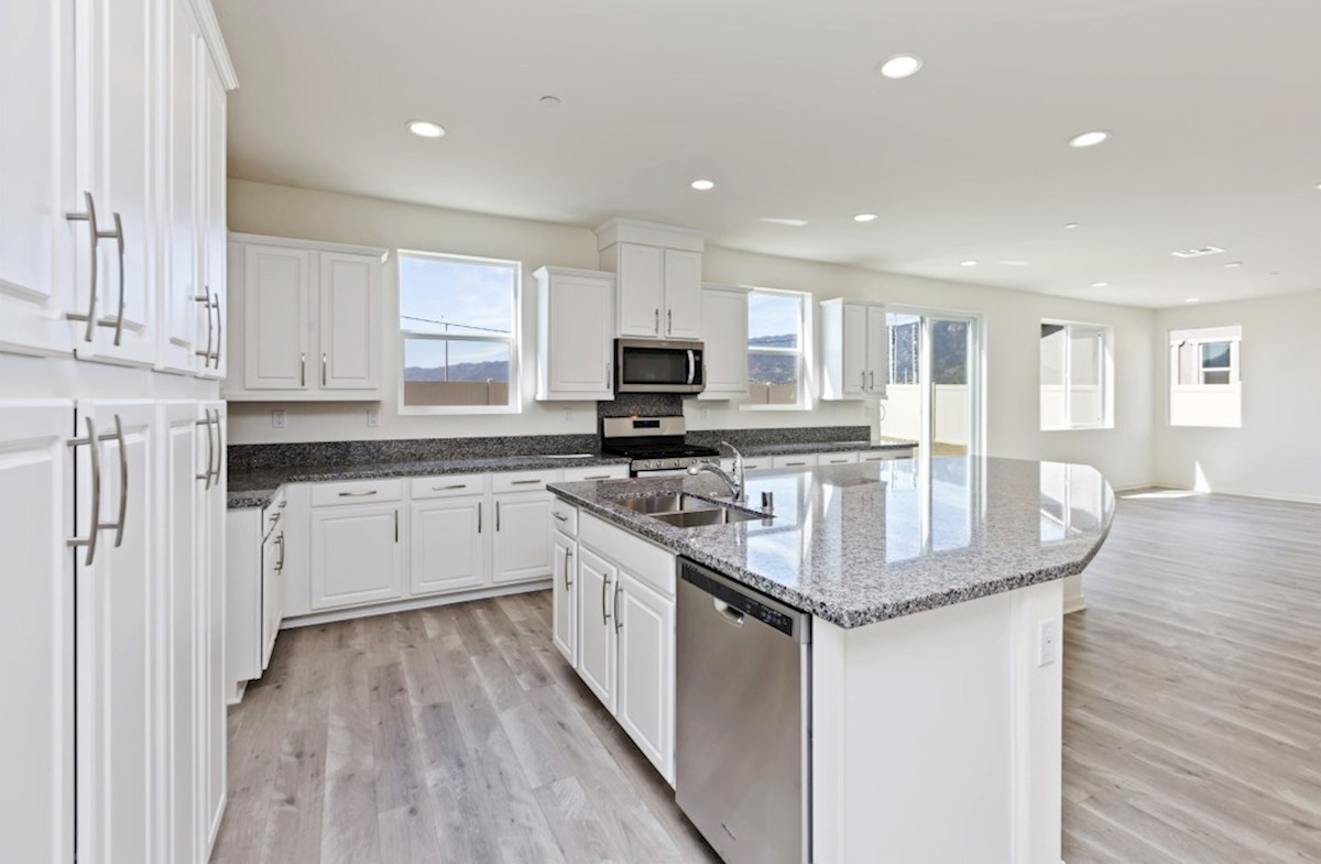 Reserve quick move-in The kitchen features spacious countertops and a walk-in pantry to maximize storage