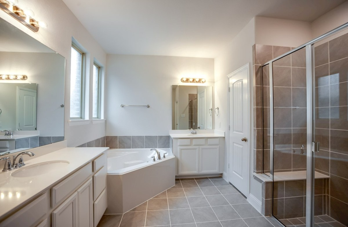 Blakely quick move-in master bath with soaking tub, walk-in shower with seat and separate vanities