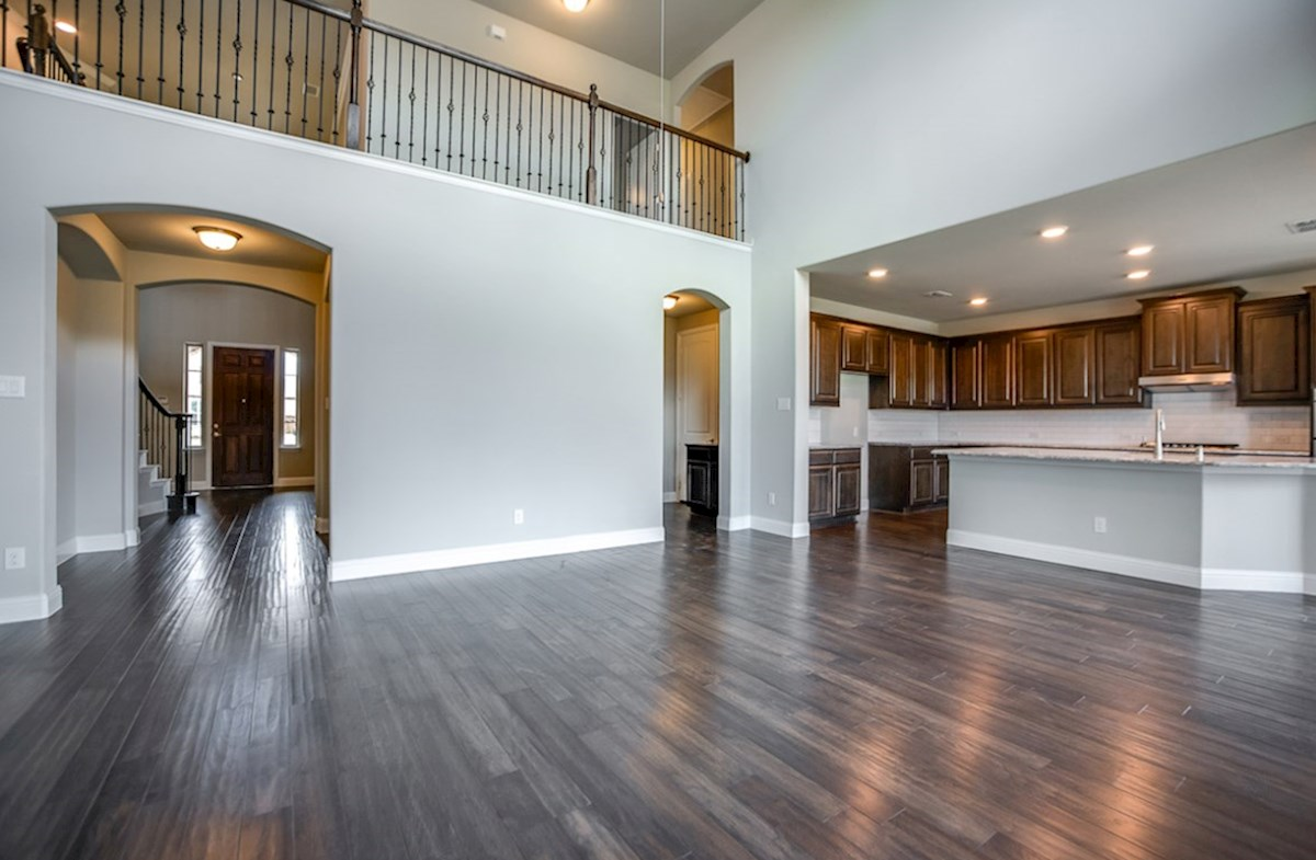 Trinity quick move-in great room with two-story ceilings and wood flooring