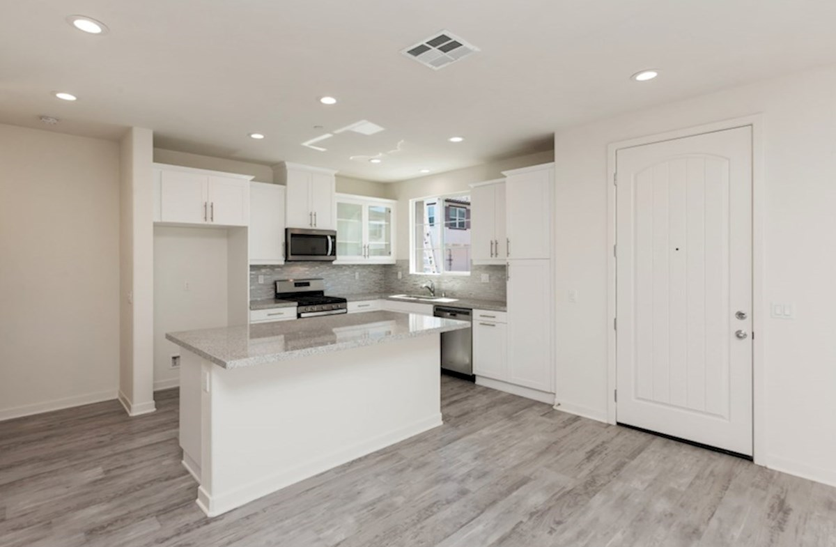 Primrose quick move-in The kitchen island is the perfect place for serving and lingering over the day's events.