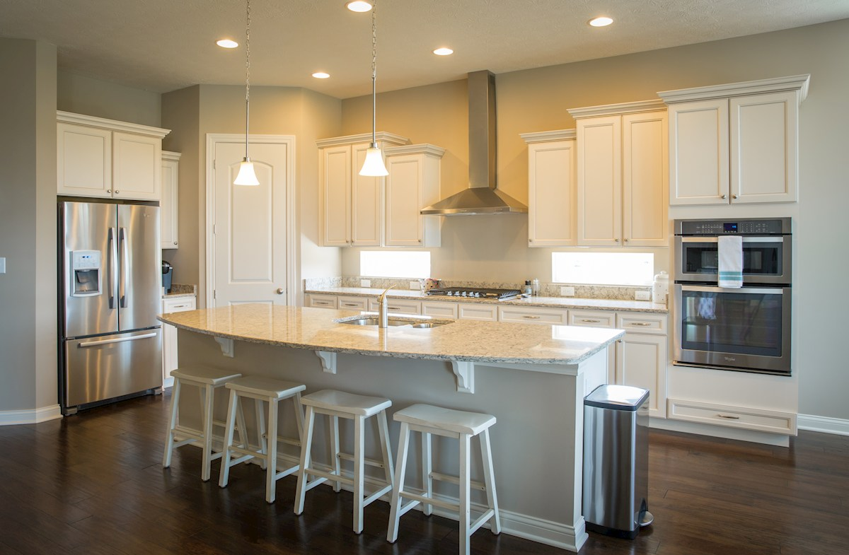 Reserve at Woodside Cambridge kitchen quartz countertops and white cabinets