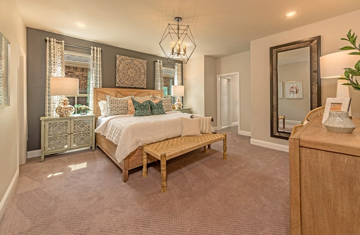The Grove at Craig Ranch Brenham Brenham large master bedroom with natural light