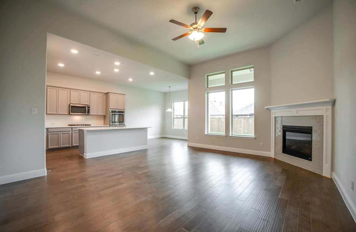 Blakely quick move-in open great room with fireplace next to kitchen