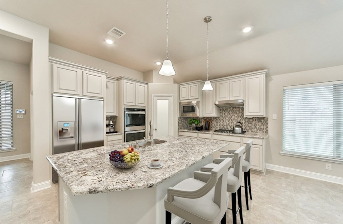 Morgan's Landing Anderson kitchen with granite countertops, pendant lighting and tile flooring