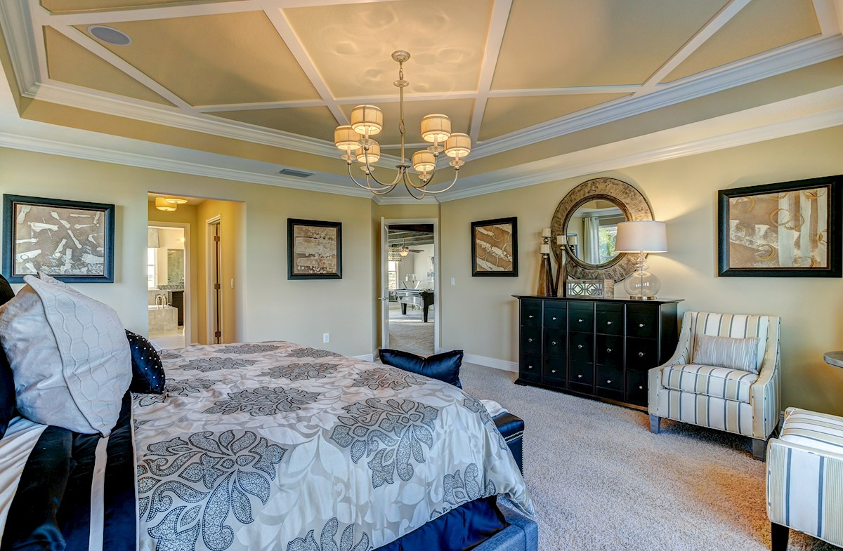 The Reserve at Pradera Sequoia master bedroom with a tray ceiling